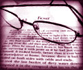 img=reading glasses on book