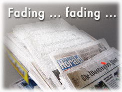 image of newspapers fading
