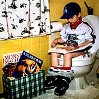 child reading while on toilet