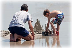 image of family building sandcastle